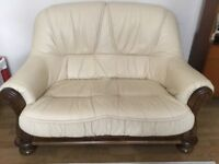 A pair of 2 seater leather and wood sofas Free