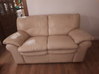 Cream Leather Two Seater Sofa.
