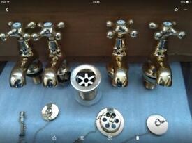 Ideal standard gold pillar bath and sink taps