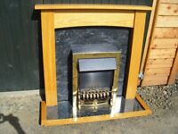 Electric fire with wood and marble effect surround, fire place. £30