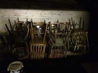 14 wooden chairs, various colours, free to collect