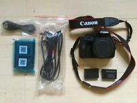 Canon EOS 100D (Entry Level DSLR body + 2 batteries, charger and Micro USB)