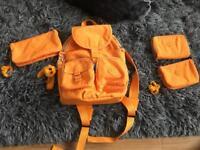 Kipling backpack with wallets.