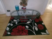 Lovely Glass coffe table with wrought iron base