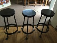 Three old industrial bar stools