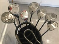Golf clubs - various metal fairways, a hybrid and a cart bag - no longer required