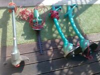 three electric grass strimmers plus one hedge strimmer