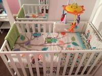 Cot with mattress, bedding and mobile