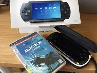 Sony PSP with Original Box And Two Games