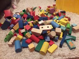 Over 200 wooden blocks and wooden cactus, trucks