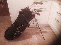 Titleist Driver-Titleist 3&5 Woods-Titleist Irons-Titleist Vokey Lob Wedge-Odyssey Putter-Nike Bag