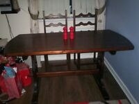 Brown Wooden Table and four chairs with cushions, very good condition