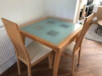 Extendable Dining Room Table and matching four chairs