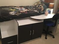 Children's single cabin bed with desk and storage