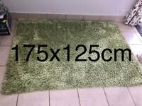 Green shaggy rug