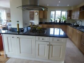 Kitchen cupboards and black granite worktops