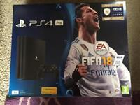 Playstation 4 pro with fifa 18 new and sealed