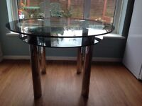 Harveys Round Glass and Chrome Dining Table