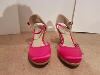 Brand new size 7 pink wedge heels