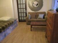SUPERB SPACIOUS GROUND FLOOR STUDIO FLAT WITH REAR PATIO NEAR TUBE ONLY 2 STOPS TO BAKER STREET