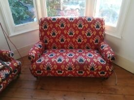 Vintage red patterned armchair and sofa