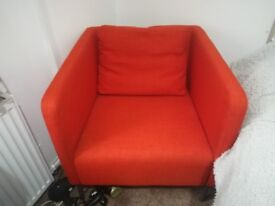 Large orange fabric arm chair
