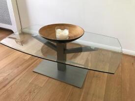 Glass coffee table with metallic base