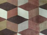 Brand new high-quality Origin rug for sale. Chocolate colour with retro design.
