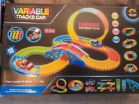 Neon light up car and track set with batteries.