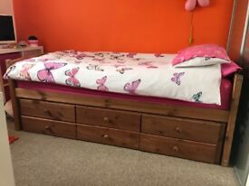 Pine effect wooden bed, storage draws & pull out