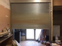 REMOTE CONTROLLED STAINLESS STEEL ELECTRIC SECURITY ROLLER SHUTTER - 310cm x 265cm