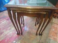 Antique mahogony nested tables glass top green leatherette