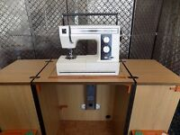 Horn type sewing machine cabinet