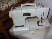 ELECTRIC SEWING MACHINE IN VERY GOOD CONDITION.