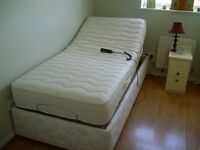 Single electric adjustable bed in immaculate condition.