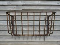 Two decorative iron hay racks.