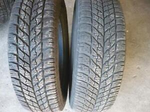 Two 225-65-16 snow tires  $80.00