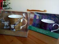 Two mug, coaster & tray sets