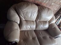 Leather sofa and arm chair for sale.