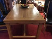 Light oak extending dining table and six chairs