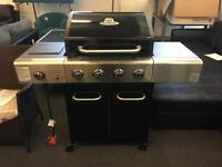 Brand New 4 Burner Gas Barbecue with storage underneath.