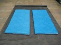 Two Blue and Orange Sleeping Bags