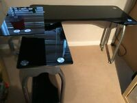 Black Glass office desk, can be used straight or as a corner unit.