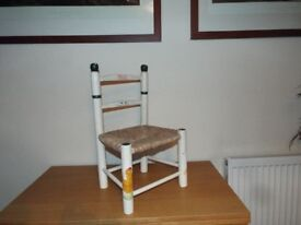 childs chair with wicker seat