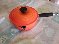 Le Creuset set of 3 Cast Iron Saucepans with Lids in Volcanic Orange