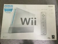 Wii console, leads and controllers all in original box plus extras