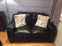 Black leather 2 seater sofa free