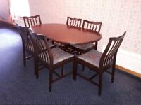Extending dining table and 6 matching chairs