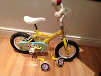 Little girls yellow bike with stabilisers