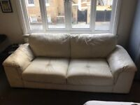Italian leather sofa + pouffe for sale, cream in colour, fairly good condition